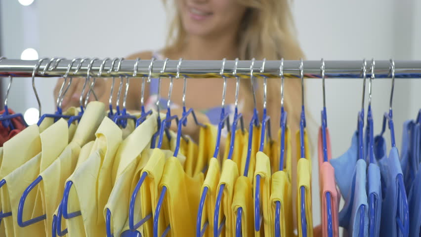 Girl seek cloth in showroom on demonstration stand | Shutterstock HD Video #22459984