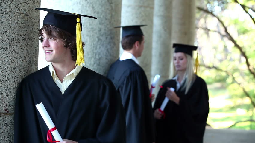 Portrait of a male graduate in foreground leaning against column #2246110