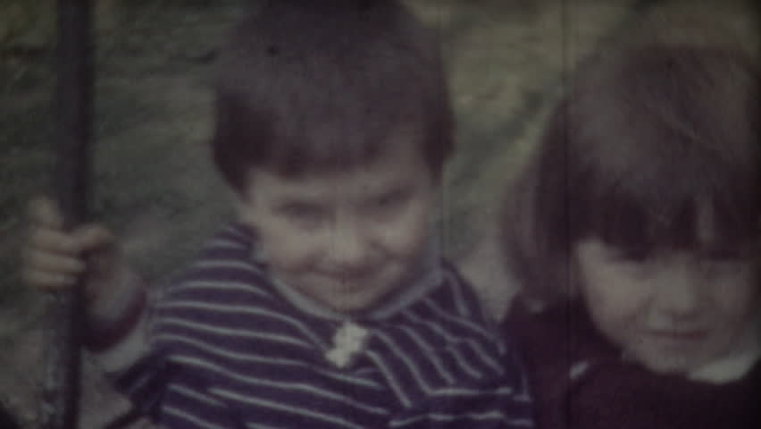 Children on swing. 8mm retro video.