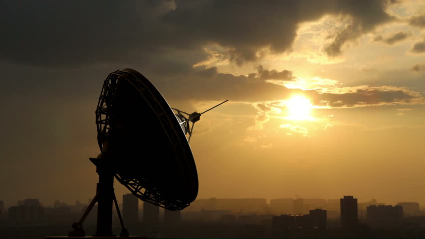 rotating radio telescope at sunset, 3d animation against sky background