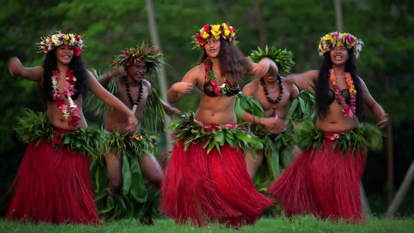 Young males and females in a group of Tahitian hula dancers performing outdoor barefoot in traditional costume Tahiti French Polynesia South Pacific