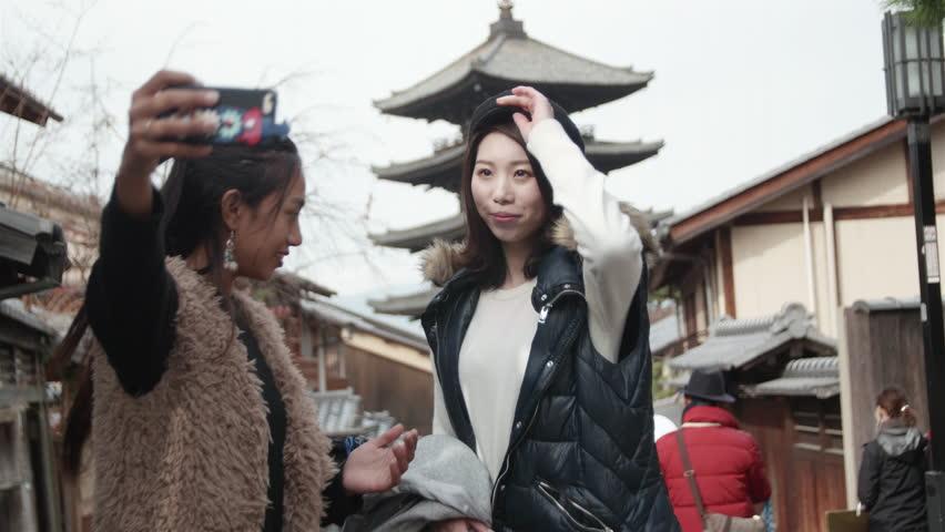 Young International friends take selfie in front of famous temple landmark in Kyoto  | Shutterstock HD Video #22541497