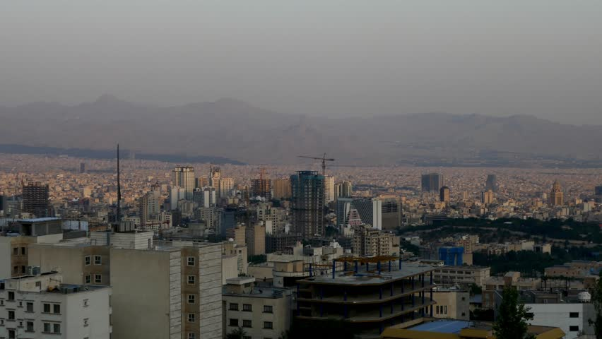 Long shot of cityscape of Tehran the capital of Islamic republic of Iran with sun light over the buildings  | Shutterstock HD Video #22556989