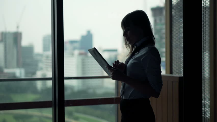 Young businesswoman working with tablet computer standing by window at home  #22558882