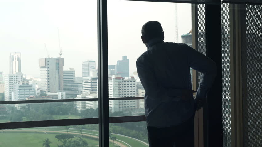 Young businessman dressing, preparing for work by window at home   #22559089