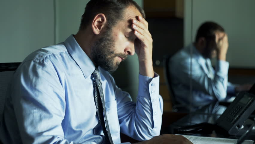 Young businessman having headache during work on laptop in office   #22559116