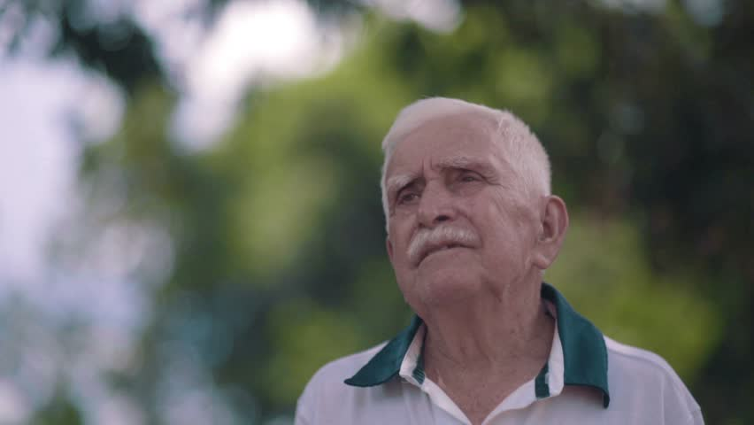 Close up of a smiling old man looking to the horizon - farmer - Thoughtful elderly | Shutterstock HD Video #22586224