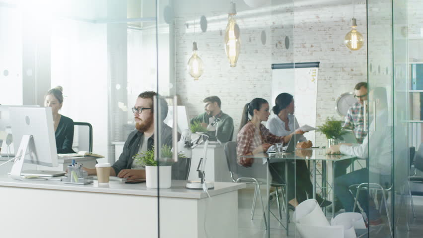 Weekday in a Busy Creative Bureau. Office People Working at Their Personal Computers, Talking on the Phone. At Conference Table Business Discussion is Happening. Shot on RED EPIC (uhd). | Shutterstock HD Video #22607170