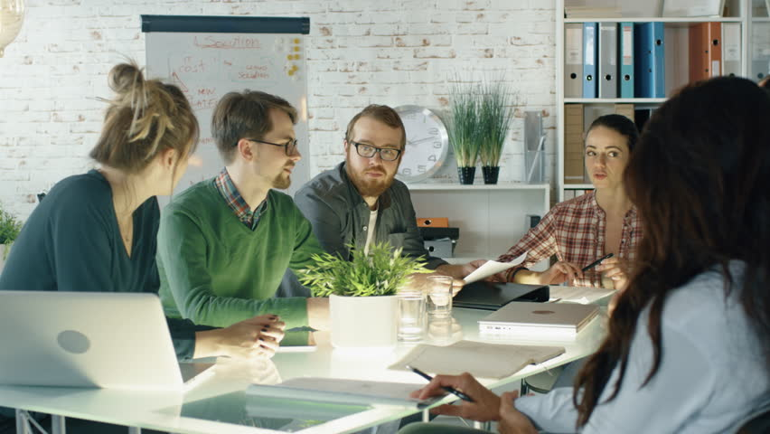 Busy Creative Office Strategic Planning Session is on the Way. Diverse Crowd of Stylish Young People Have Energetic Discussion. Shot on RED EPIC (uhd).   Shutterstock HD Video #22607182