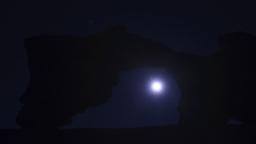 Timelase of Moon Passing Through Tukuhnikivatz Arch near Arches National Park and Moab, Utah USA | Shutterstock HD Video #22608262