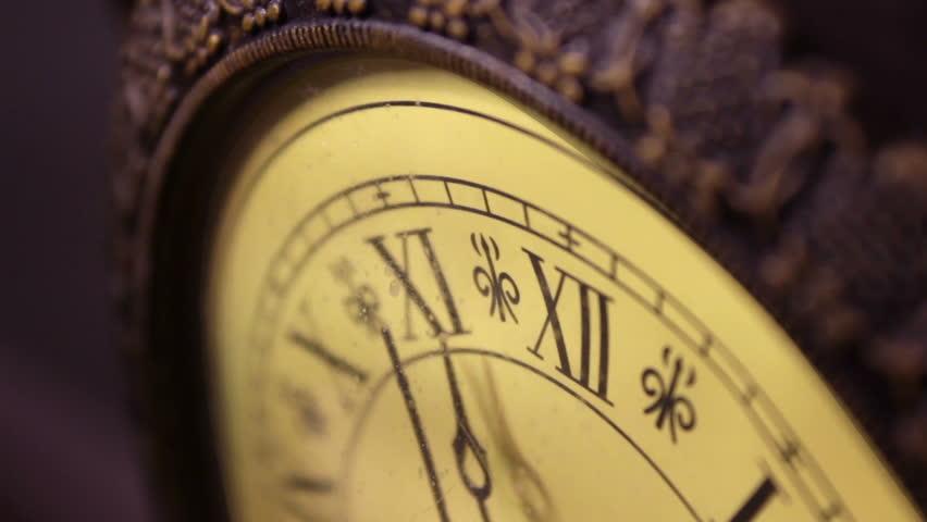An old antique bronze clock ticks slowly by  December 5 2015   Shutterstock HD Video #22646182