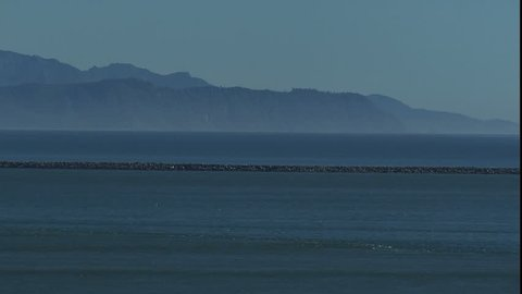 tidal rip, zoom back to reveal light house at mouth of the Columbia river