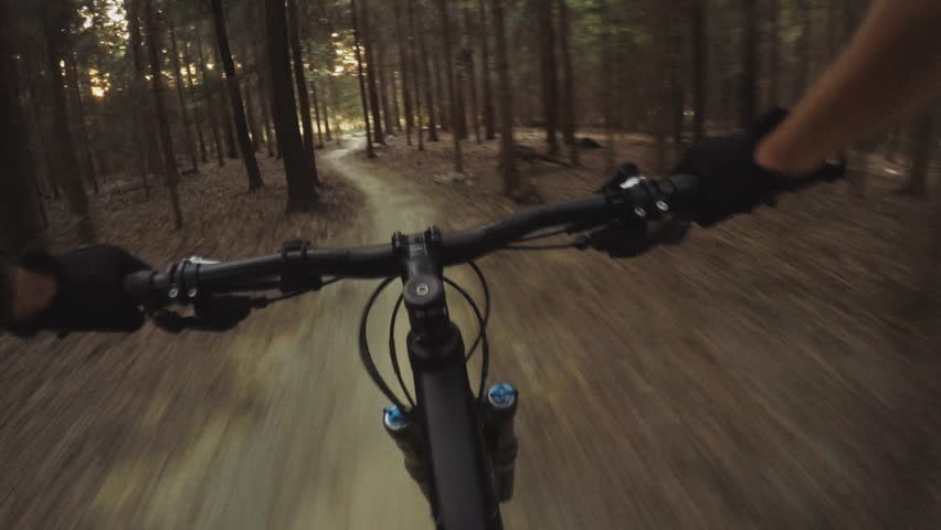 MTB bike riding on enduro mountain track trail in autumn forest. Mountain biking downhill in woods. View from first person perspective POV. Gimbal stabilized video.    Shutterstock HD Video #22706371