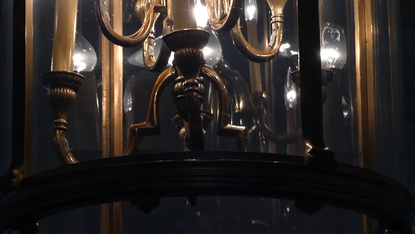 A Lamp Candlestick Chandelier in an Impressive Down up Shot | Shutterstock HD Video #22709680