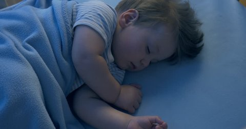 Close-up night shot of an adorable baby sleeping in the night time.