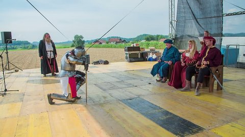 SENTRUPERT FESTIVAL SEPTEMBER 2016 A young knight is swinging his sword and then he puts his head down and goes on one knee to take a bow in front of the royal family.
