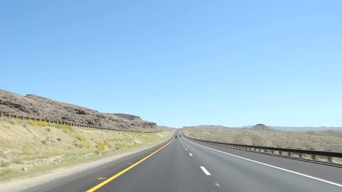Nevada interstate highway drive time-lapse, few cars on the road on a sunny day