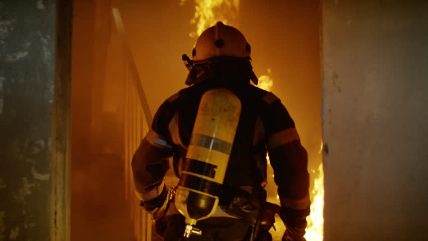 Two Brave Firefighters Go Up Burning Stairs. They Go Through Open Doors. Building is on Fire. Open Flames and Smoke Everywhere. Slow Motion.  Shot on RED EPIC 4K (UHD). | Shutterstock HD Video #22783501