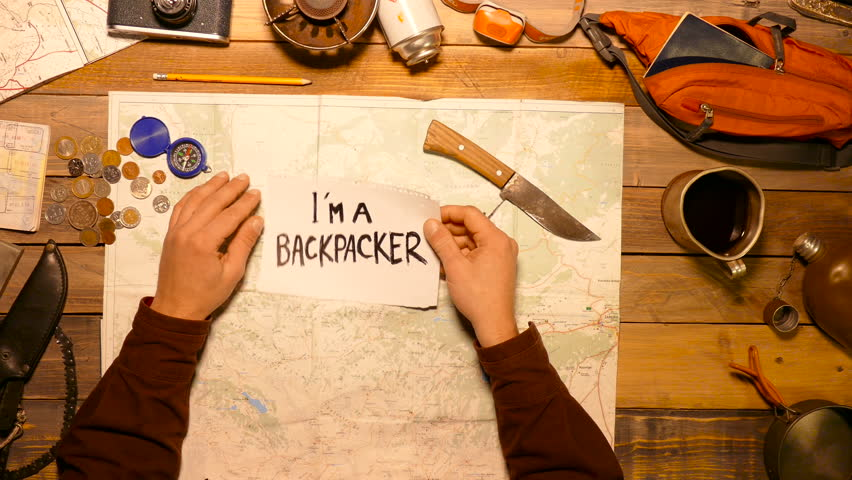 I'm a backpacker - tittle on the white paper. Top view. | Shutterstock HD Video #22789690
