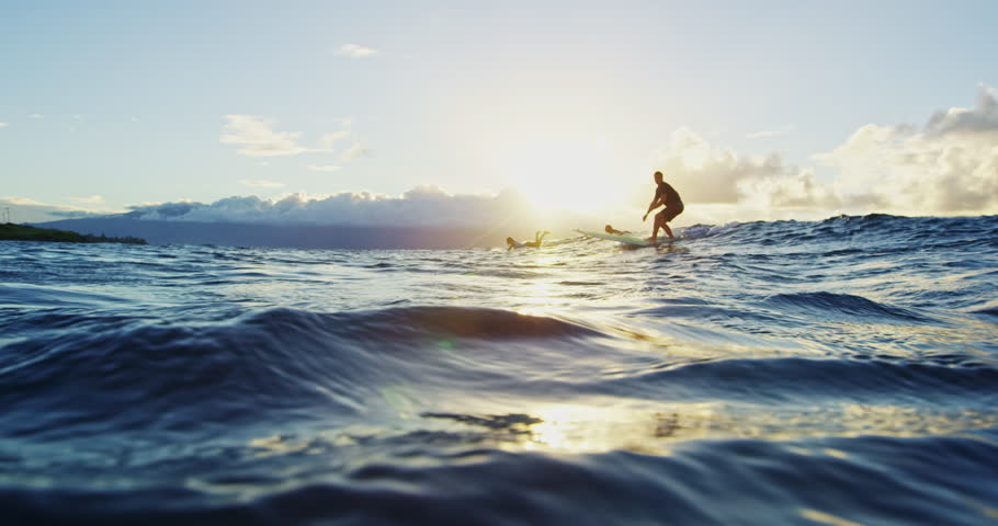 Young Man Surfing at Sunset in Slow Motion. Shot on RED in 4K. Summer Extreme Sports   Shutterstock HD Video #22800895