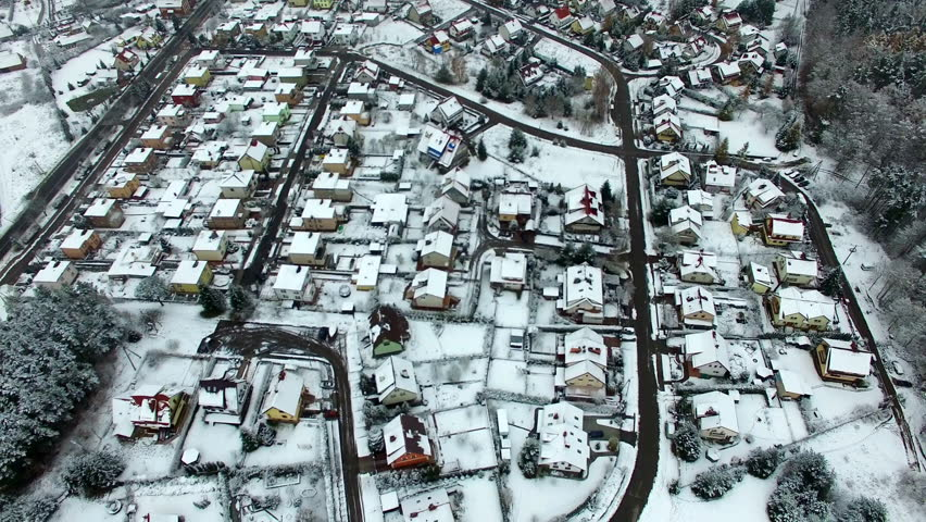 Aerial Of Residential Neighborhood Lakes And Woods In Winter