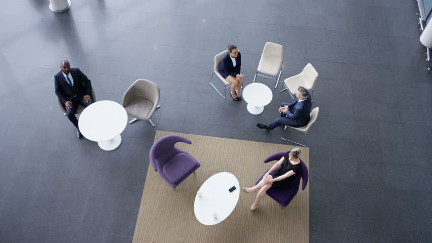 4K Overhead view business group in meeting area of large modern office building Dec 2016-UK | Shutterstock HD Video #22826410