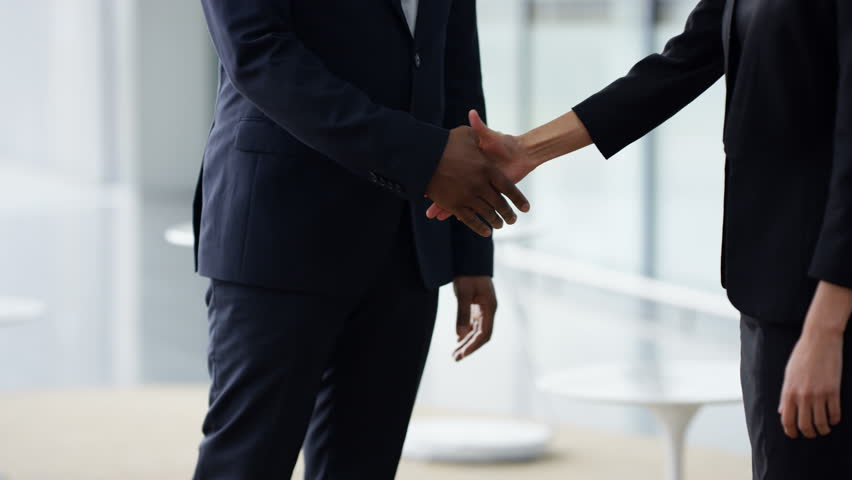 4K Portrait smiling businessman shaking hands with clients at end of meeting Dec 2016-UK Royalty-Free Stock Footage #22828255