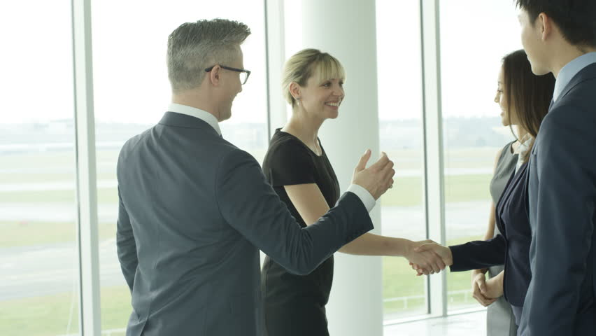 4K Business teams meet & shake hands in large modern office building Dec 2016-UK #22829059
