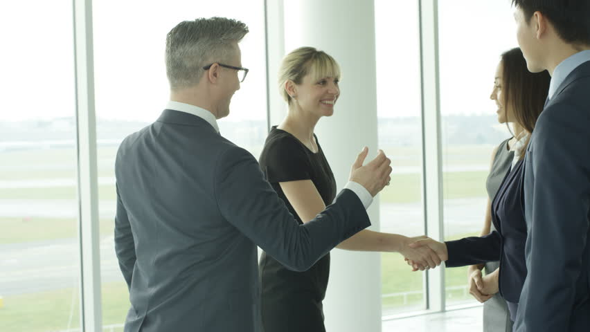 4K Business teams meet & shake hands in large modern office building Dec 2016-UK #22829119