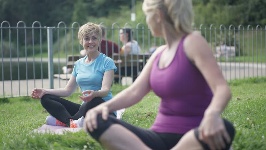 4K Happy mature female friends doing yoga & meditating in the park Dec 2016-UK | Shutterstock HD Video #22852942