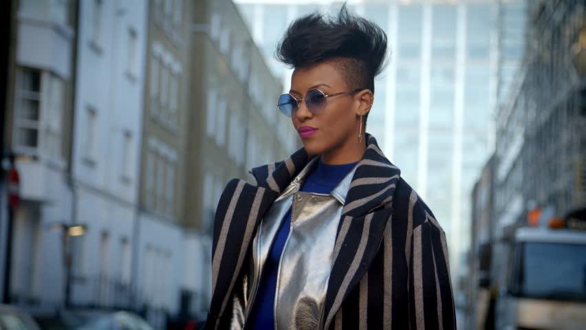 Stylish Fashion Blogger Standing In Urban Street | Shutterstock HD Video #22853542