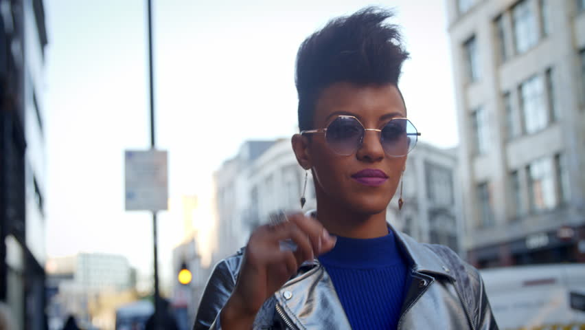 Portrait Of Stylish Fashion Blogger Standing In Urban Street | Shutterstock HD Video #22853551