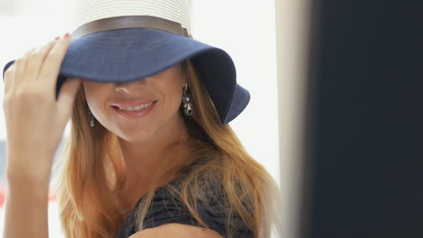 Woman in hat posing at big mirror closeup | Shutterstock HD Video #22854913