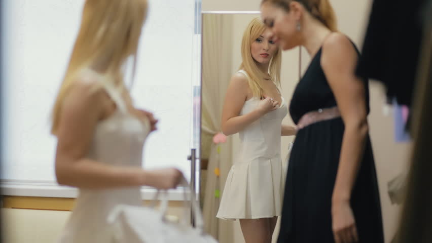 Friends happily shopping together in clothing store | Shutterstock HD Video #22855465