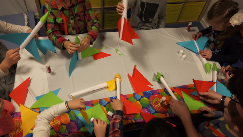 ST PETERSBURG, RUSSIA-8 March 2016, Children at the table of colored paper glue space rocket | Shutterstock HD Video #22877140