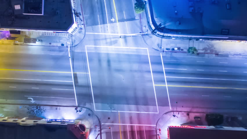 Vertical top down aerial view of traffic on street intersection at night. Camera Rotating. 4K UHD loop timelapse.   Shutterstock HD Video #22901023