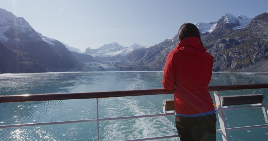 Alaska cruise ship passenger tourist looking at landscape in Glacier Bay National Park, USA. Woman on travel sailing Inside Passage enjoying view of Johns Hopkins Glacier | Shutterstock HD Video #22901653
