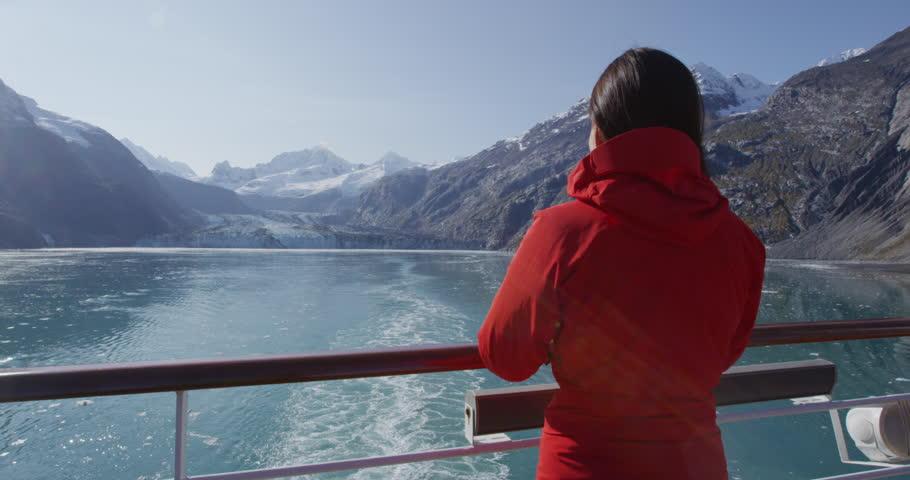 Glacier Bay Alaska cruise ship passenger looking at glacier in Glacier Bay National Park, USA. Woman on travel sailing Inside Passage enjoying view of Johns Hopkins Glacier. | Shutterstock HD Video #22901659