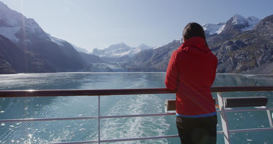 Alaska cruise ship passenger tourist looking at landscape in Glacier Bay National Park, USA. Woman on travel sailing Inside Passage enjoying view of Johns Hopkins Glacier. | Shutterstock HD Video #22901902