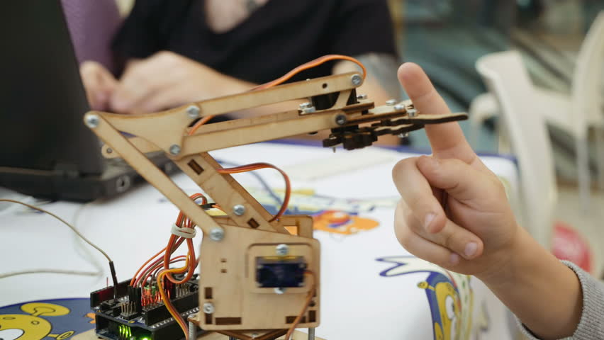 Small toy robot arm helps children to learn and understand robotics technology. Robots and automation are substitute for future human labor. | Shutterstock HD Video #22909111