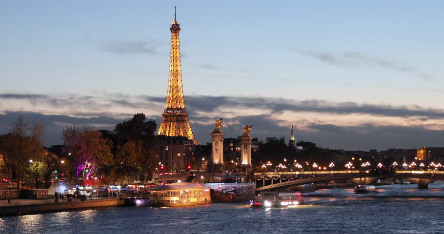 PARIS, FRANCE - September 20, 2016: View of the Seine River by night with cruise tour boats.  | Shutterstock HD Video #22910404
