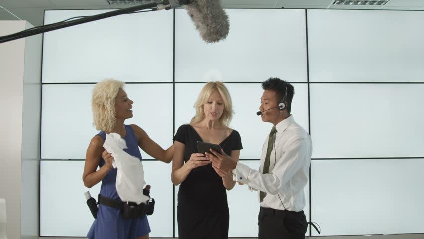 4K TV crew & presenter in studio, preparing to go live on air Dec 2016-UK | Shutterstock HD Video #22926715
