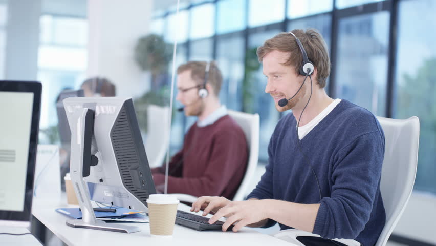 4K Multiracial telesales team talking to customers in busy call center Dec 2016-UK