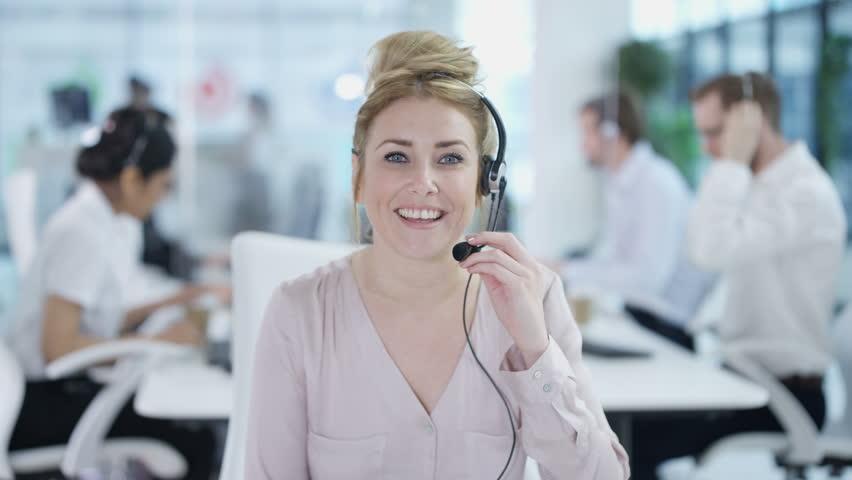 4K Friendly customer service adviser talking to a customer via video call Dec 2016-UK