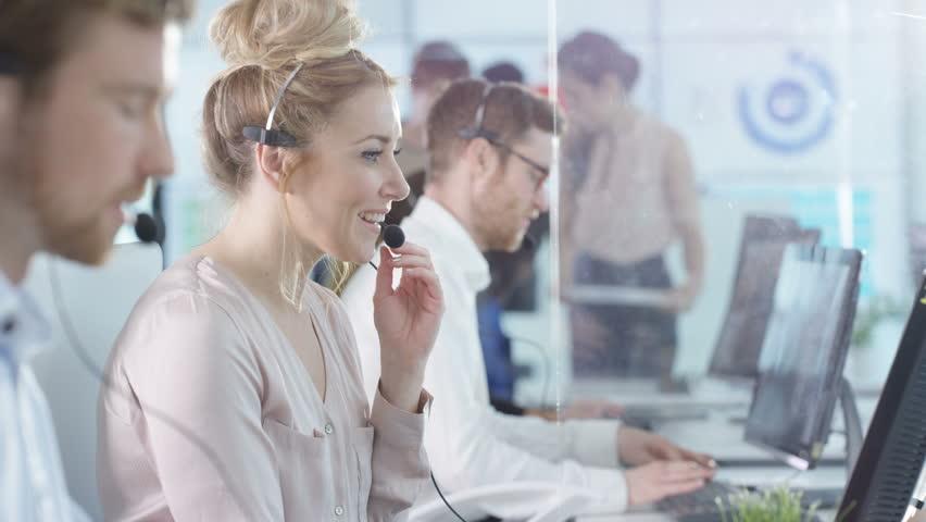 4K Friendly customer service operators taking calls in busy call center Dec 2016-UK | Shutterstock HD Video #22933825