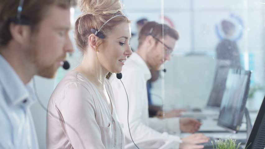 4K Friendly customer service operators taking calls in busy call center Dec 2016-UK