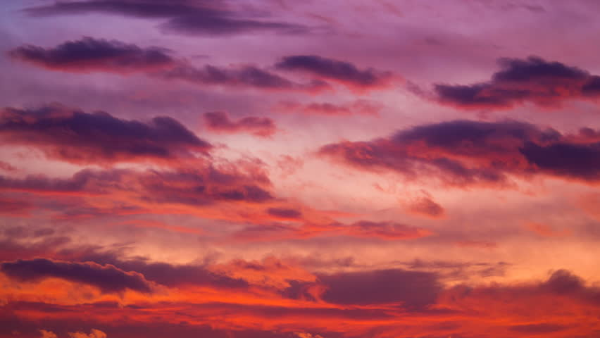 Red sunset sky time lapse. Clouds timelapse nature background. Orange yellow sun light sky clouds landscape. Dramatic evening sun set beauty. Twilight, dusk dawn summer. Bright red, purple dark sunset