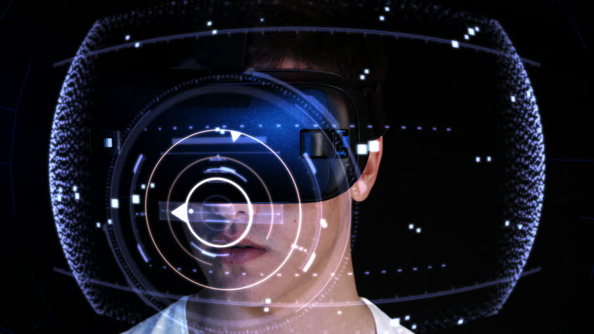 Close-up shot of a young man wearing VR Headset playing virtual reality games. Futuristic hud around him. Royalty-Free Stock Footage #22943266