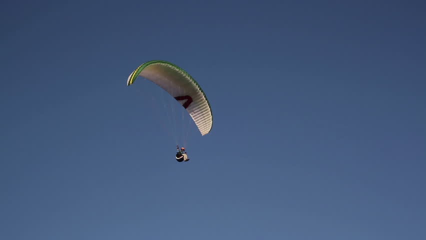 Paraglider soaring in the blue sky | Shutterstock HD Video #22951117