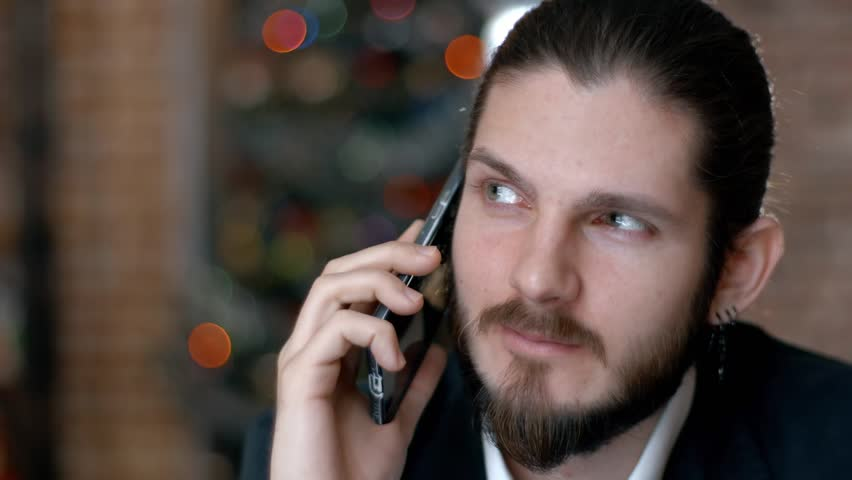 Handsome bearded businessman talking on the phone cheerfully during his coffee break on the cafe terrace #22958926